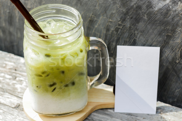 Iced green tea latte with blank name card Stock photo © nalinratphi
