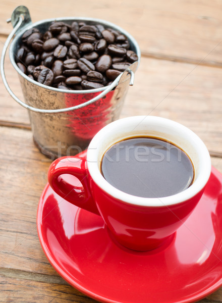 Red cup of espresso on wooden table Stock photo © nalinratphi