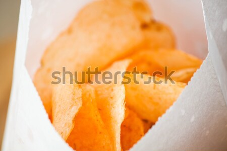 Opened bag of delicious spicy potato chips Stock photo © nalinratphi
