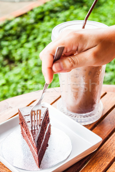 Soft chocolate cake and iced coffee serving on table Stock photo © nalinratphi