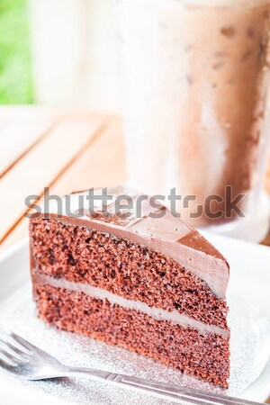 Bitter sweet meal with cold coffee and chocolate cake  Stock photo © nalinratphi