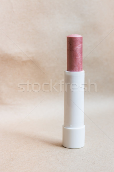 Moisturizer lipstick on brown natural background Stock photo © nalinratphi