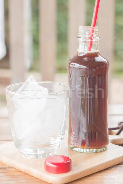 Bottle of black coffee with ice Stock photo © nalinratphi