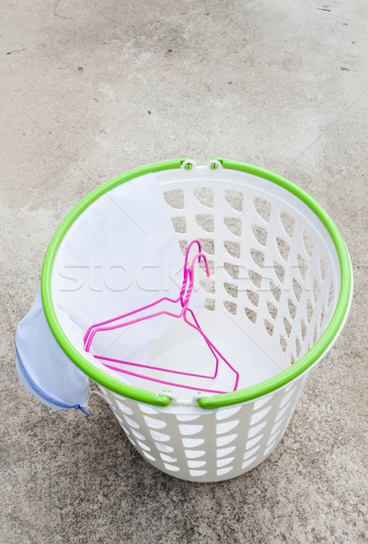 Cloth hanger and wash bag in plastic laundry basket   Stock photo © nalinratphi