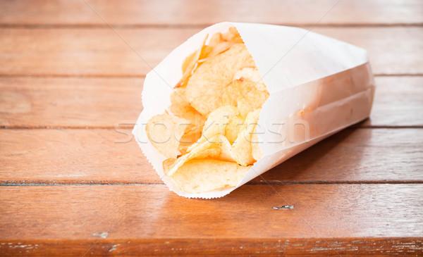 картофельные чипсы таблице сумку белый Сток-фото © nalinratphi