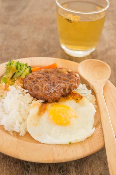Rice with hamburg steak and fried egg Stock photo © nalinratphi