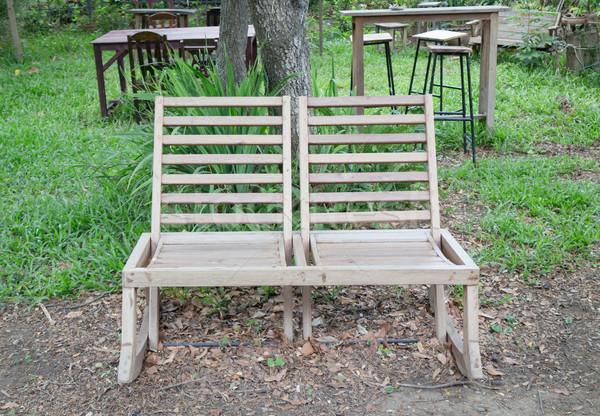 Double outdoor wooden chairs in garden Stock photo © nalinratphi