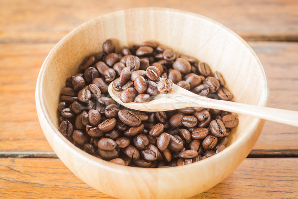 Roasted coffee beans in wooden bowl Stock photo © nalinratphi