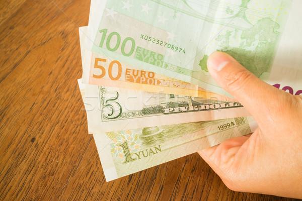 Hand valuta bank nota houten tafel voorraad Stockfoto © nalinratphi