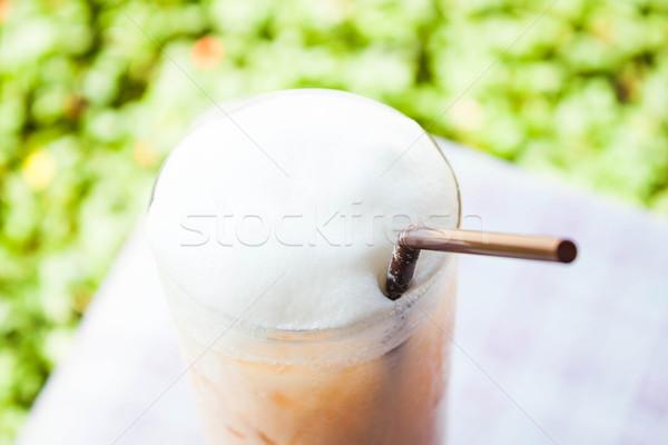 Iced thai milk tea with milk foam Stock photo © nalinratphi