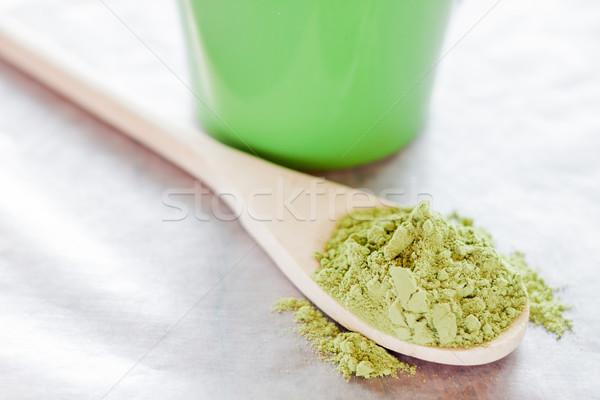 Powdered green tea with wooden spoon  Stock photo © nalinratphi