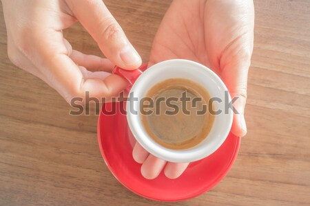 Hands holding cup of hot coffee Stock photo © nalinratphi