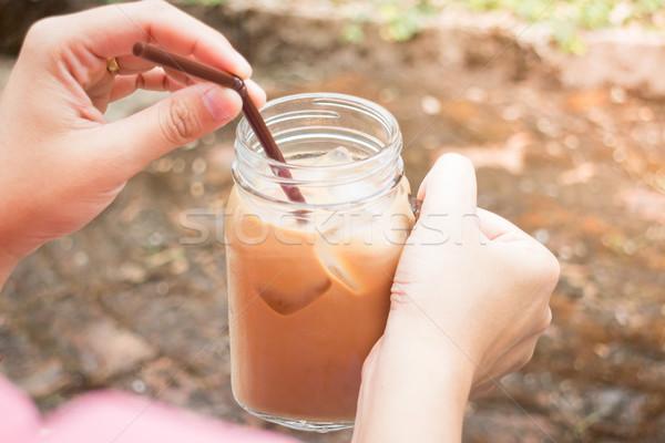 Kéz üveg jeges tej kávé klasszikus Stock fotó © nalinratphi