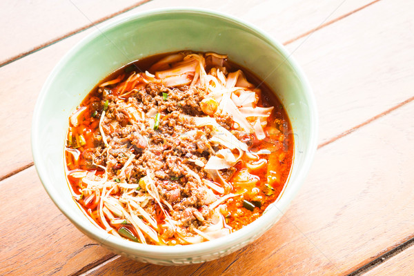 Bowl of spicy noodle soup, northern of thailand style cuisine Stock photo © nalinratphi