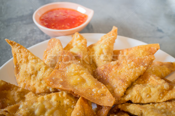 Homemade fried dumplings serving on the plate Stock photo © nalinratphi