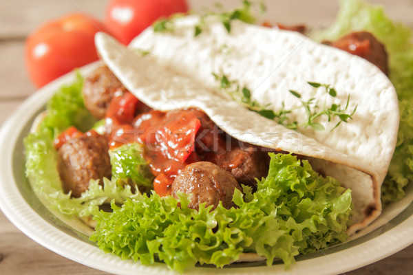meatballs with cabbage on lettuce in pita bread Stock photo © Naltik