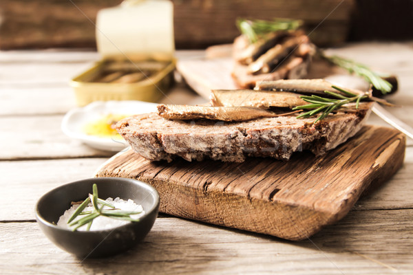 Sandwich Tapas with sardines, sprats with olives and salt Stock photo © Naltik