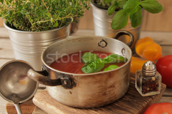 tomato soup with basil in a pot on the marble Stock photo © Naltik
