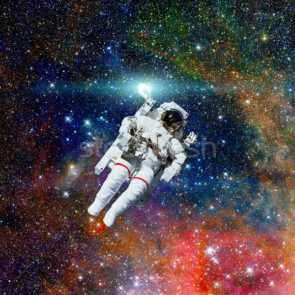 Astronaut in outer space. Nebula on the background. Stock photo © NASA_images