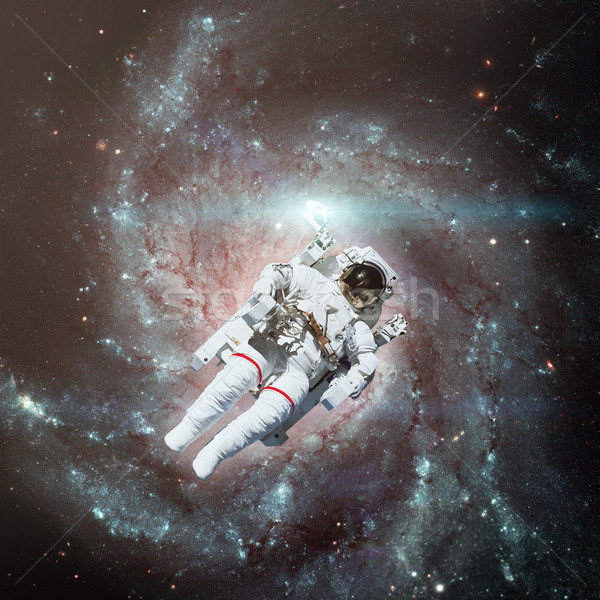 Astronaut in outer space. Spiral galaxy on the background. Stock photo © NASA_images