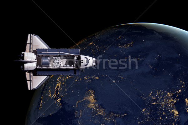 Stock photo: Space Shuttle and aerial night view of the World.