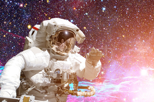 Stock photo: Astronaut in outer space. Galaxy and stars on the background.