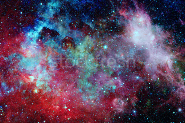 Colored nebula and open cluster of stars in the universe. Stock photo © NASA_images