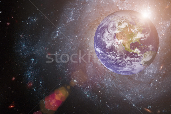 Earth and galaxy. Elements of this image furnished by NASA. Stock photo © NASA_images