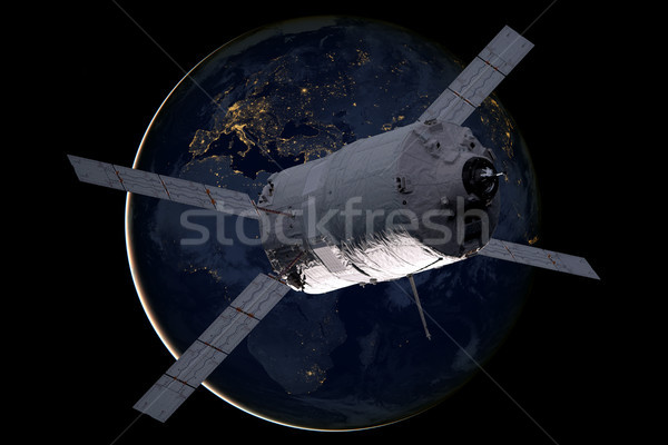 Cargo spacecraft - The Automated Transfer Vehicle over the planet Earth. Stock photo © NASA_images