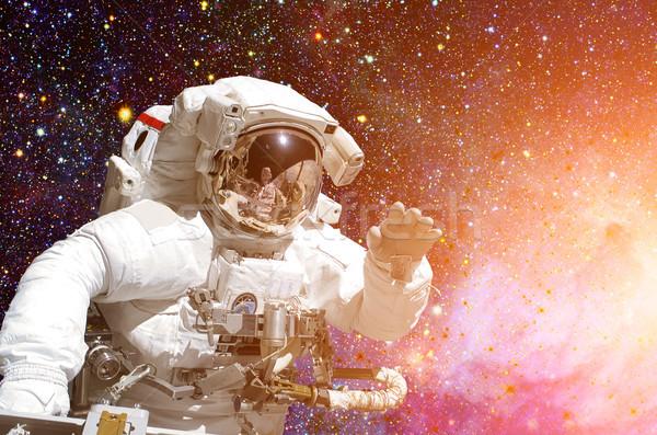 Foto stock: Astronauta · espacio · exterior · fondo · elementos · imagen · cielo