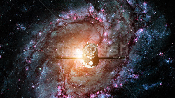 Spacecraft Progress orbiting the spiral galaxy. Stock photo © NASA_images
