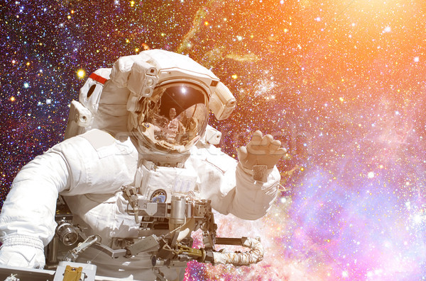 Astronaut in outer space. Galaxy and stars on the background. Stock photo © NASA_images