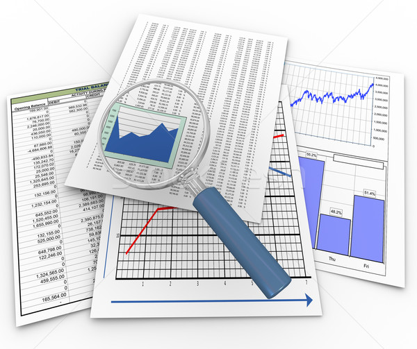 Magnifier on financial documents Stock photo © nasirkhan