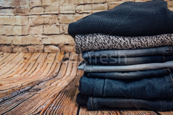 fashionable clothes. pile of jeans Stock photo © Natali_Brill
