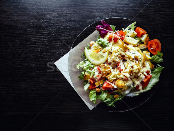 Caesar salad with prawns on the wooden table Stock photo © Natali_Brill