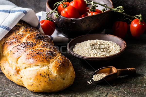 Challah is a Jewish bread to feast on wooden boards Stock photo © Natalya_Maiorova