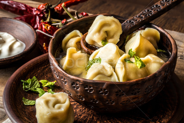 Russian dumplings with meat and broth in a rustic style Stock photo © Natalya_Maiorova