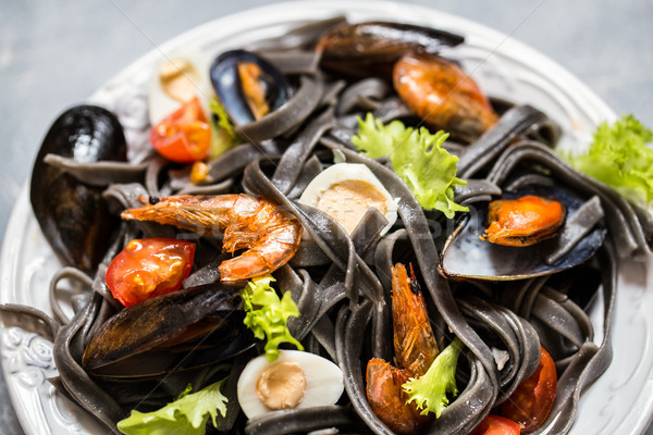 The seafood with black pasta, mussels, shrimp and vegetables Stock photo © Natalya_Maiorova