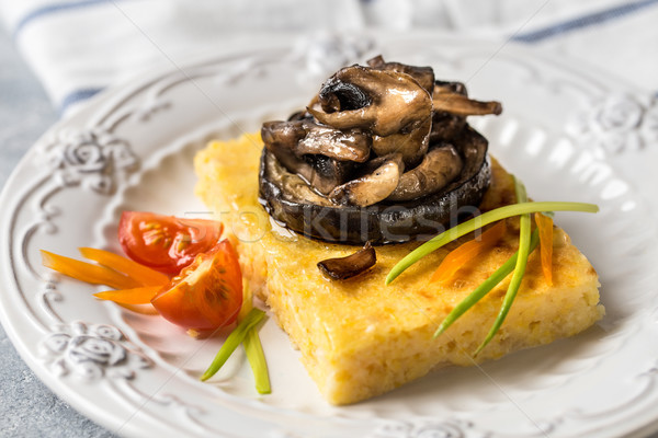 corn polenta with roasted mushrooms and eggplant, traditional Italian food Stock photo © Natalya_Maiorova