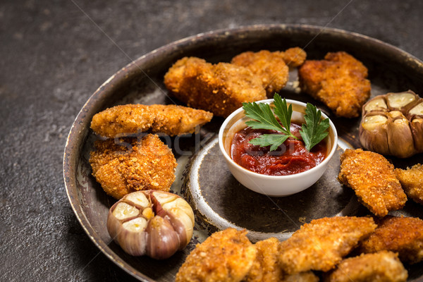 nuggets of chicken Breasts with tomato sauce with bread the sprinkles. Stock photo © Natalya_Maiorova