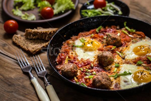 Israelense prato ovos tomates almôndegas ervas Foto stock © Natalya_Maiorova