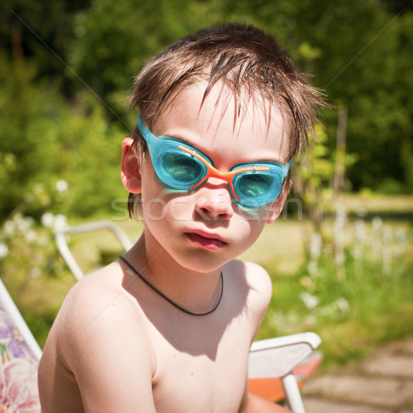 Kid in swimming googles Stock photo © naumoid