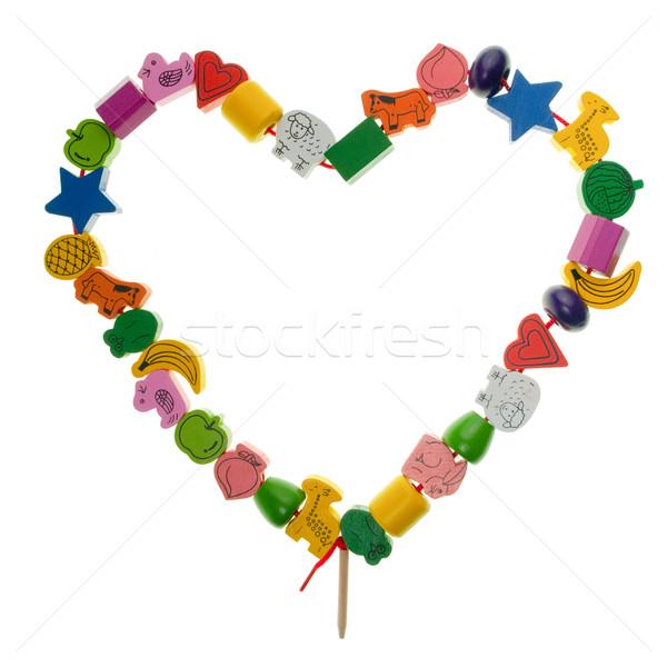 Houten speelgoed hart kleurrijk kralen vorm witte Stockfoto © naumoid