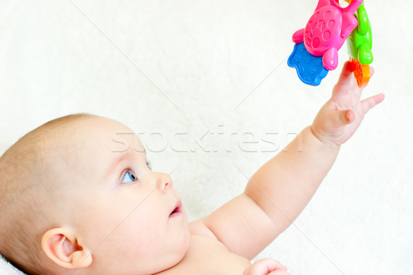 Infant with toy Stock photo © naumoid