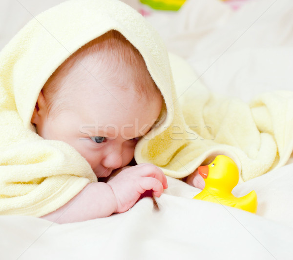 Infant playing with rubber duck Stock photo © naumoid