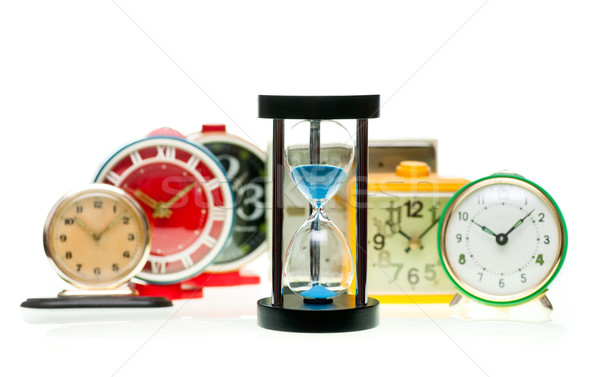 Hourglass and alarm clocks Stock photo © naumoid