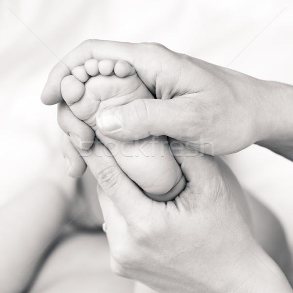 Foot massage Stock photo © naumoid