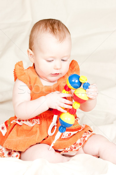 Infant with rattle Stock photo © naumoid
