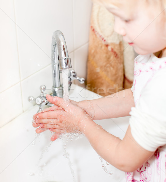 Little girl washing hands Stock photo © naumoid