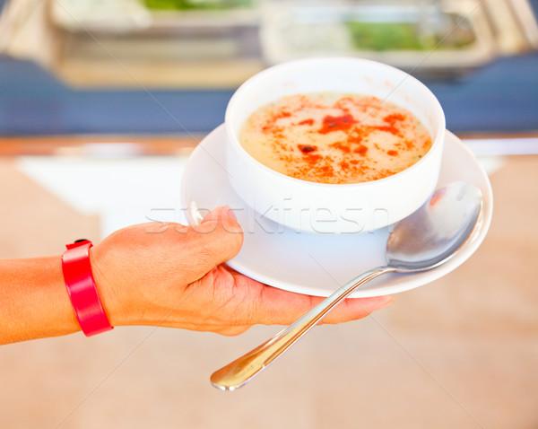 Hand holding soup Stock photo © naumoid